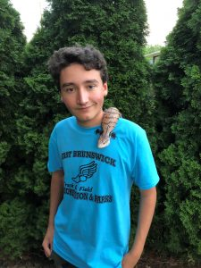Max Frederick today at 15 with his pet blue-tongue skink.
